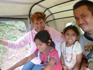 Village children enjoying a moto taxi ride in Copan